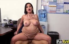 She caresses her breasts as the penis enters between her teeth