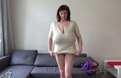 A Milf Licks Her Huge Tits