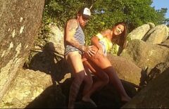 Good Brunette Gives A Blowjob And Sex On The Rocks